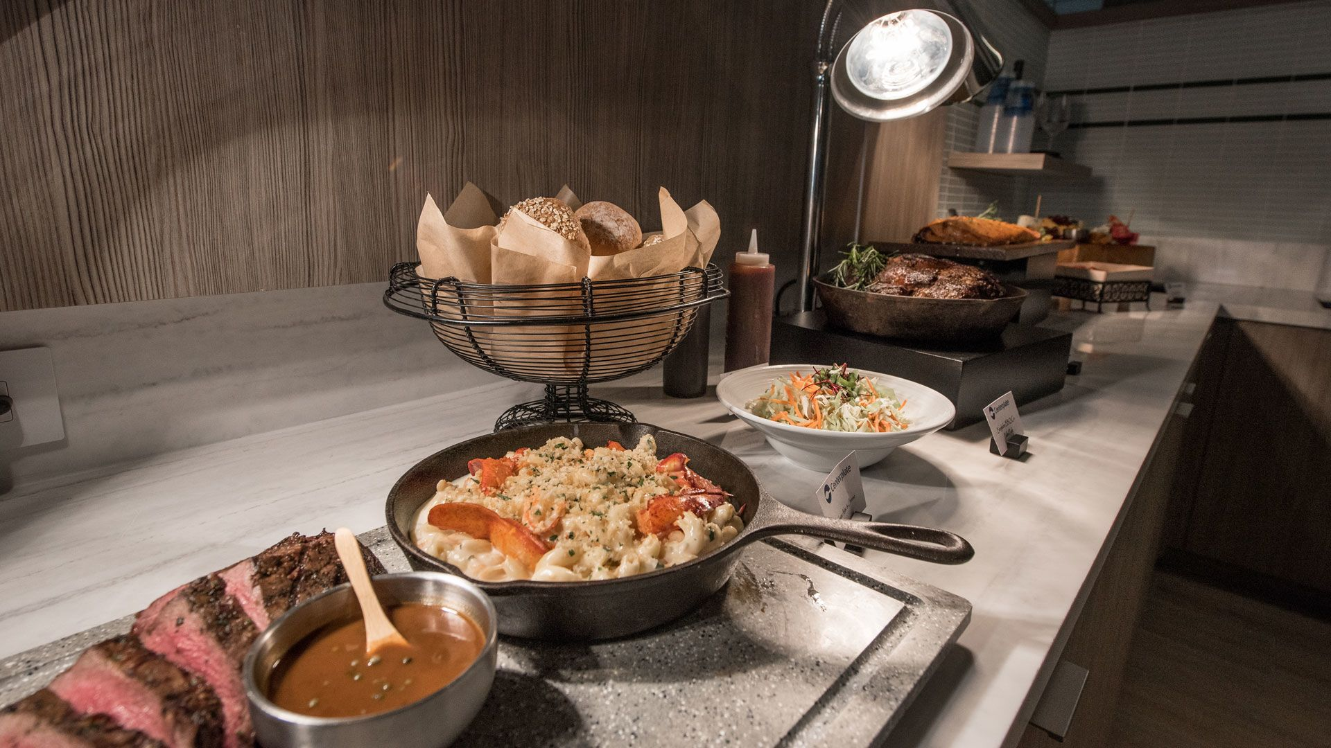 Suites Photo: Food Spread Including Steak, Lobster Macaroni and Cheese and more