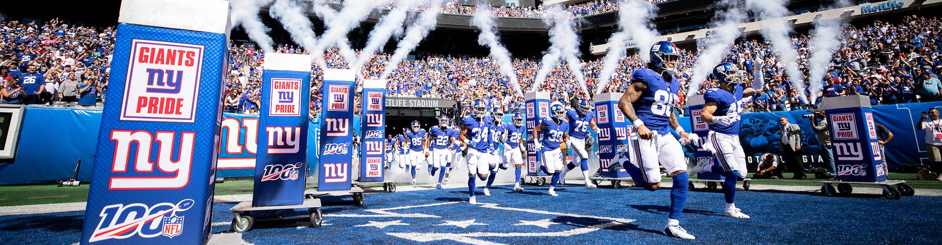 New York Giants run out of the tunnel during a regular season week 4 game against the Washington Redskins at MetLife Stadium in East Rutherford, NJ