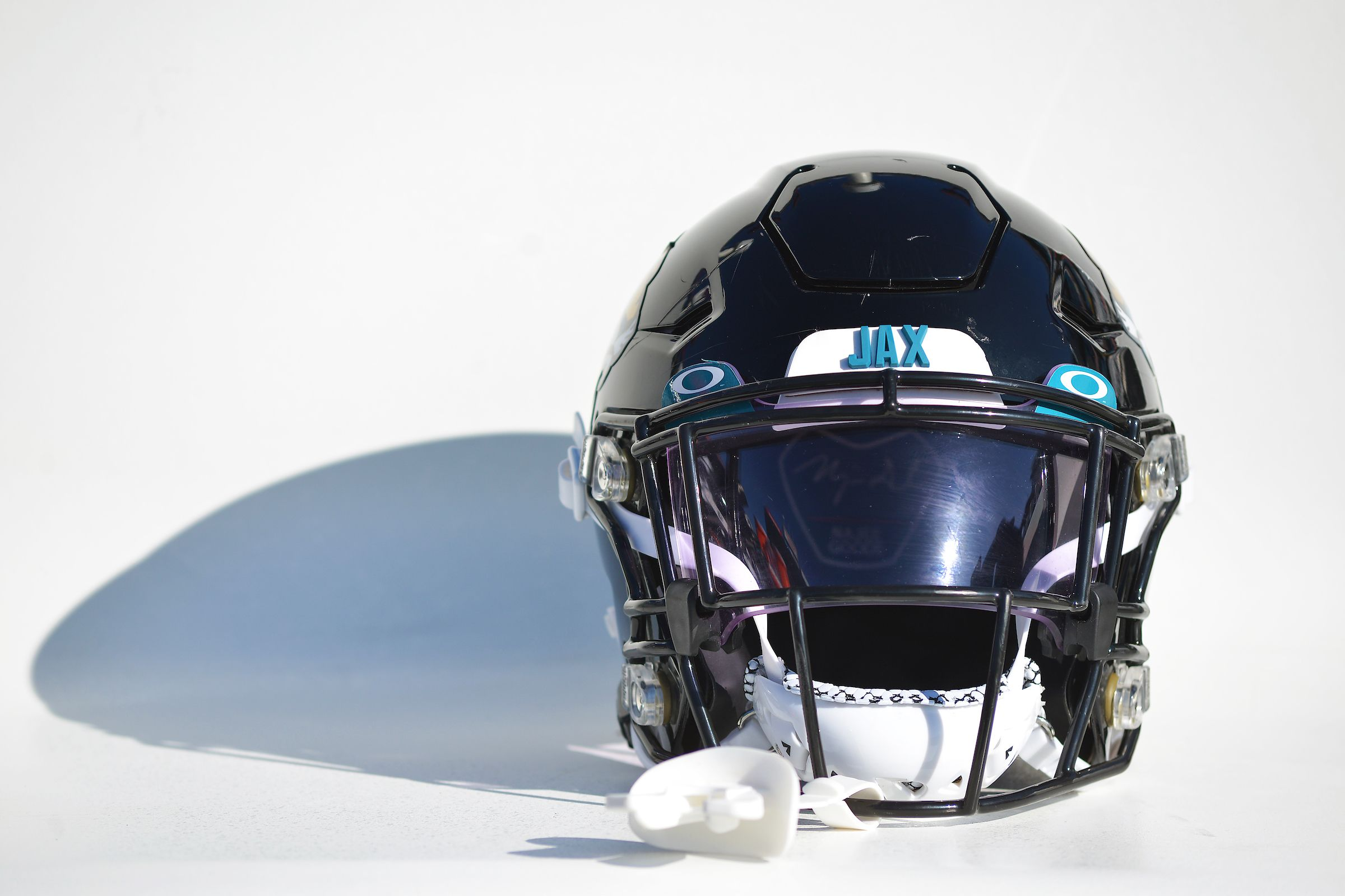 A Jacksonville Jaguars helmet rests on the bench before pregame warm-ups against the Tennessee Titans in an NFL game, Sunday, Nov. 24, 2019 in Nashville, TN.  (Rick Wilson/Jacksonville Jaguars)