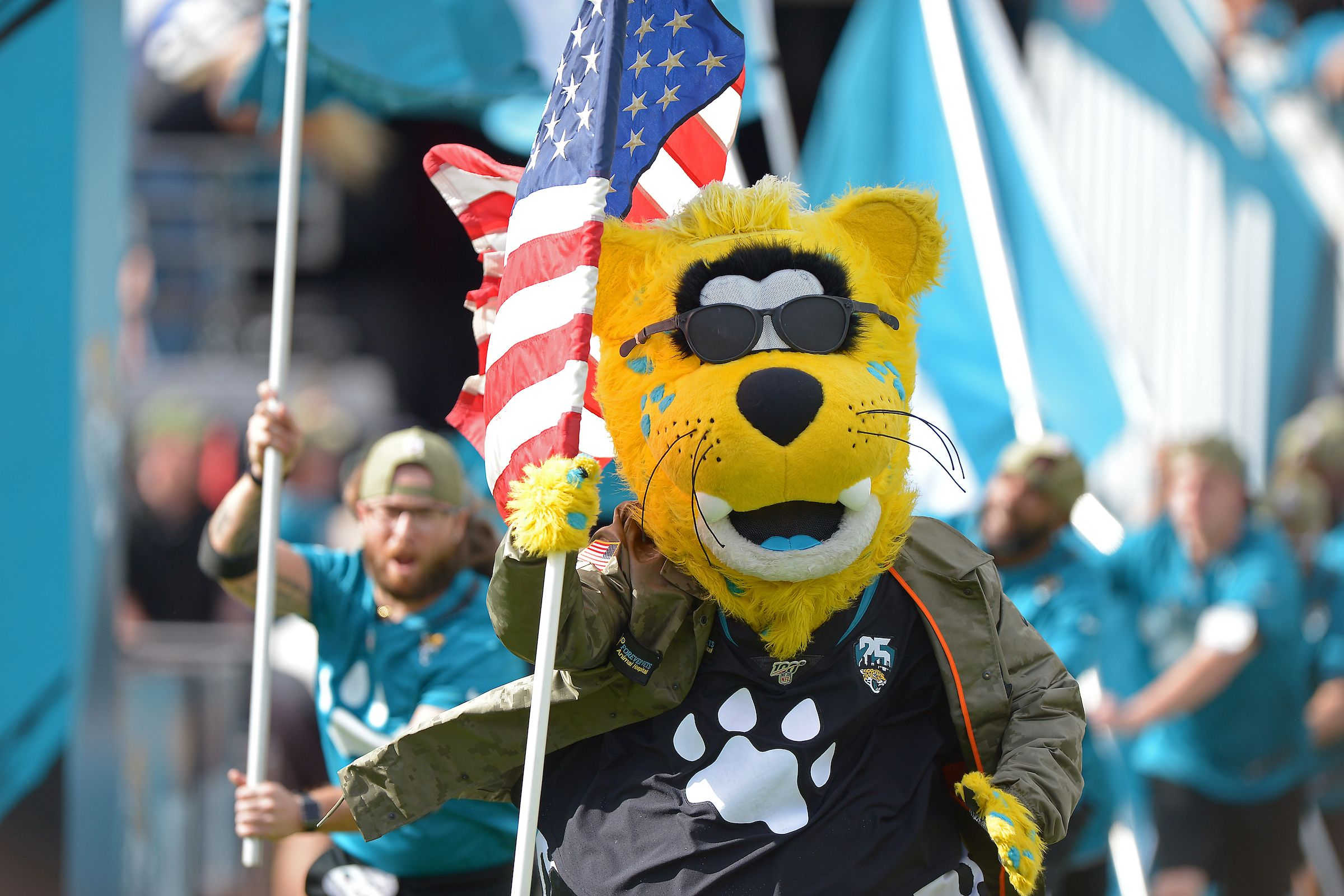 Jacksonville Jaguars mascot Jaxson de Ville carries an American flag onto the field before kick-off against the Tampa Bay Buccaneers in an NFL game, Sunday, Dec. 1, 2019 in Jacksonville, Fla. (Rick Wilson/Jacksonville Jaguars)