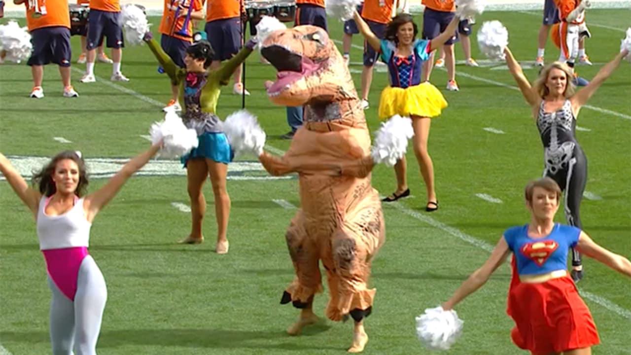 9b42f6e85 Broncos cheerleader dresses up as a dinosaur