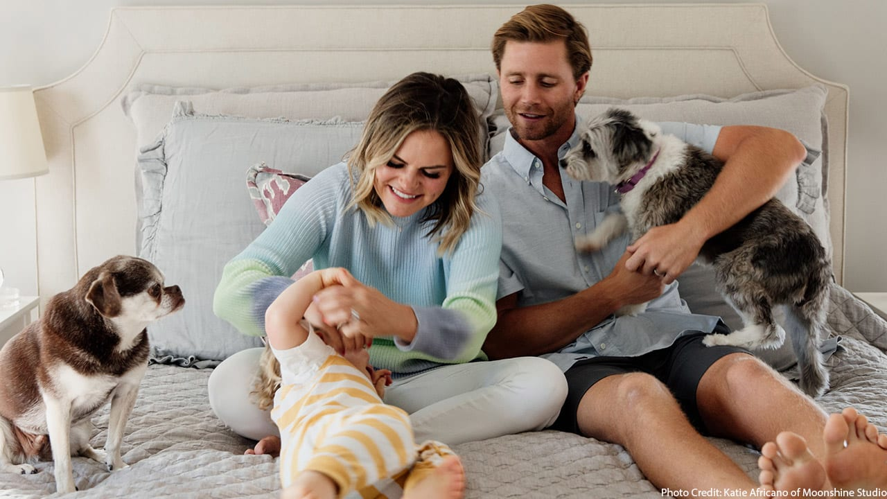 Stephen Hauschka and Lindsey Hauschka smile with their son and dogs, Jack and Bee.