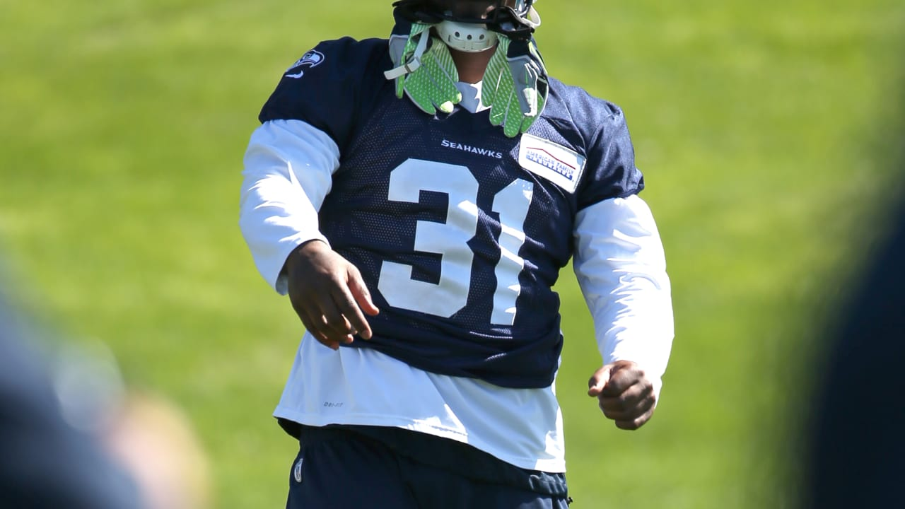 Seahawks Running Back Marshawn Lynch Wears Strong Safety Kam Chancellor s  Jersey at Practice 9e69528be