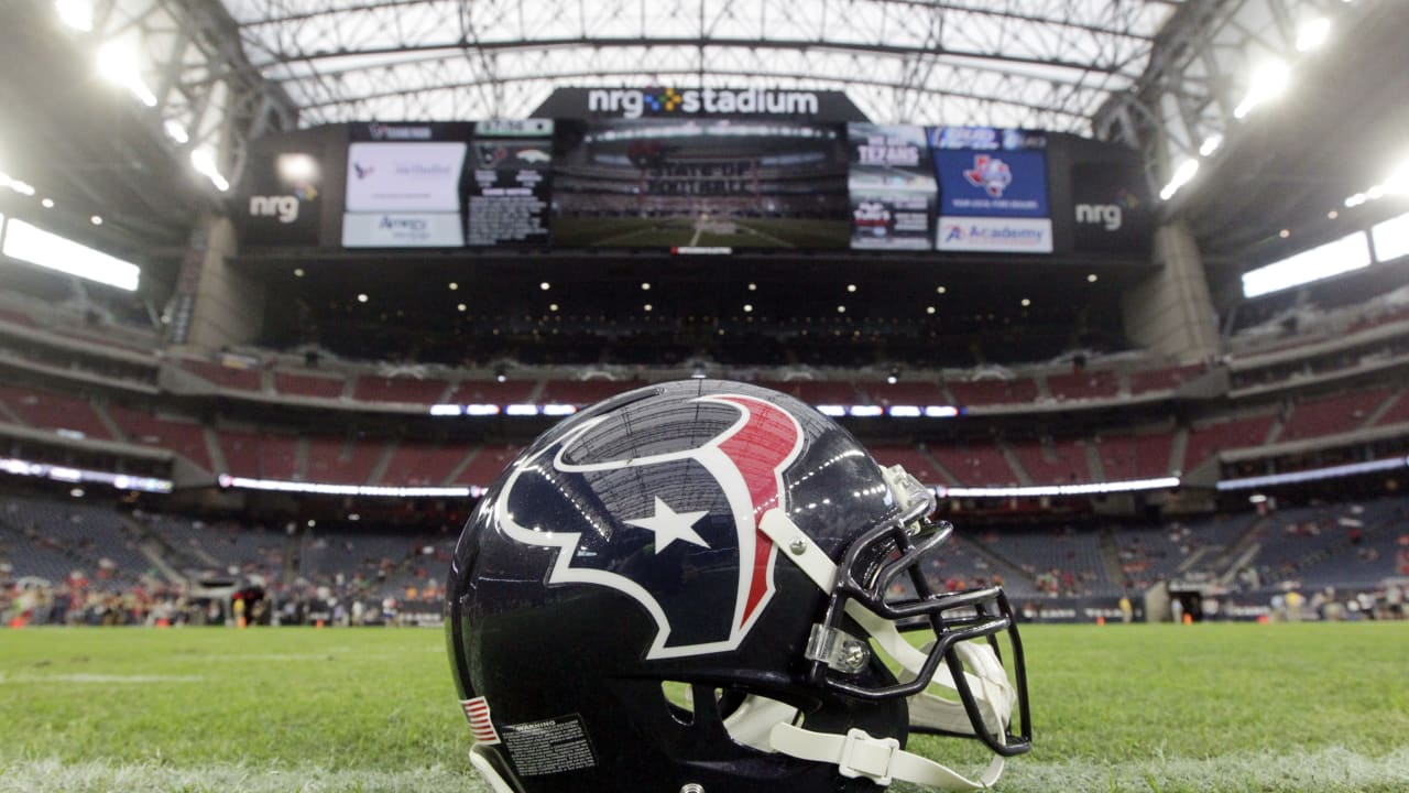 """Houston Texans Helmet sitting on the field. """"pictured here"""""""