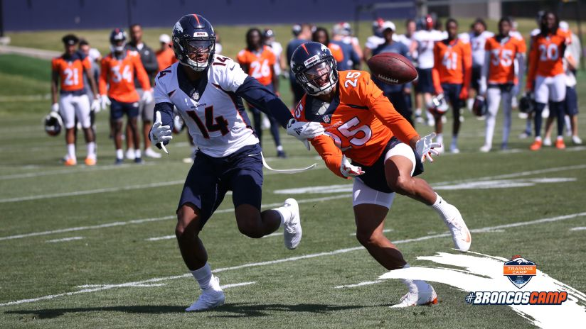 82ce67477f50e Chris Harris Jr. battles with Courtland Sutton for a deflected pass during  practice on Day