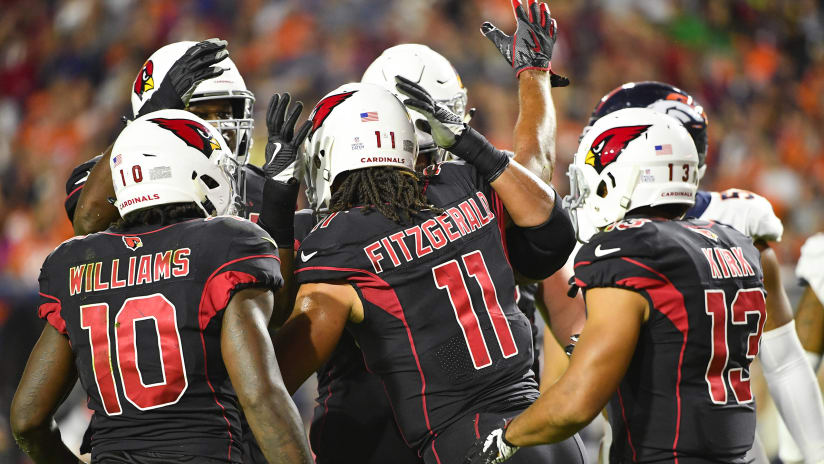5996e490be0 Larry Fitzgerald is congratulated by teammates on his first touchdown of  the season last week against