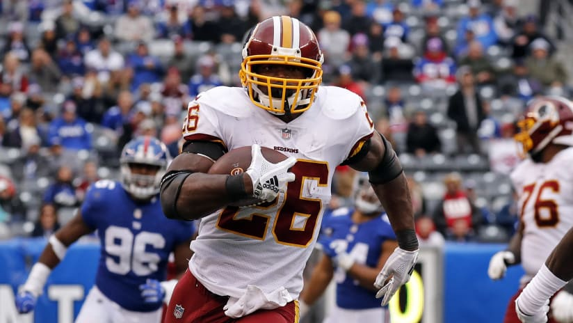 Washington Redskins running back Adrian Peterson (26) rushes for a touchdown against the New York Giants during an NFL football game Sunday, Oct. 28, 2018, in East Rutherford, N.J. (AP Photo/Adam Hunger)