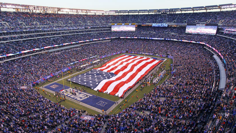 Fans watch the pre game ceremony before an NFL football game between the New  York Giants 95d1d67c6