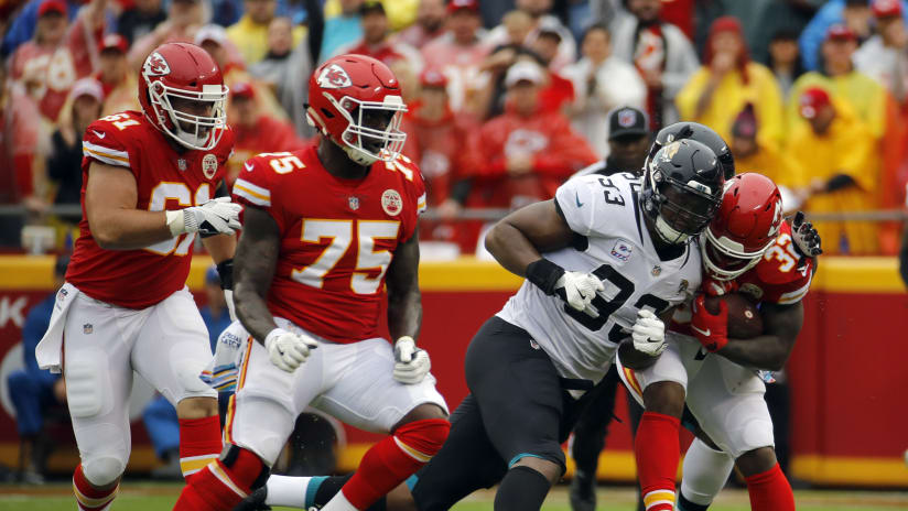 f6f3fa0e62a Kansas City Chiefs running back Spencer Ware (32) is tackled by Jacksonville  Jaguars defensive