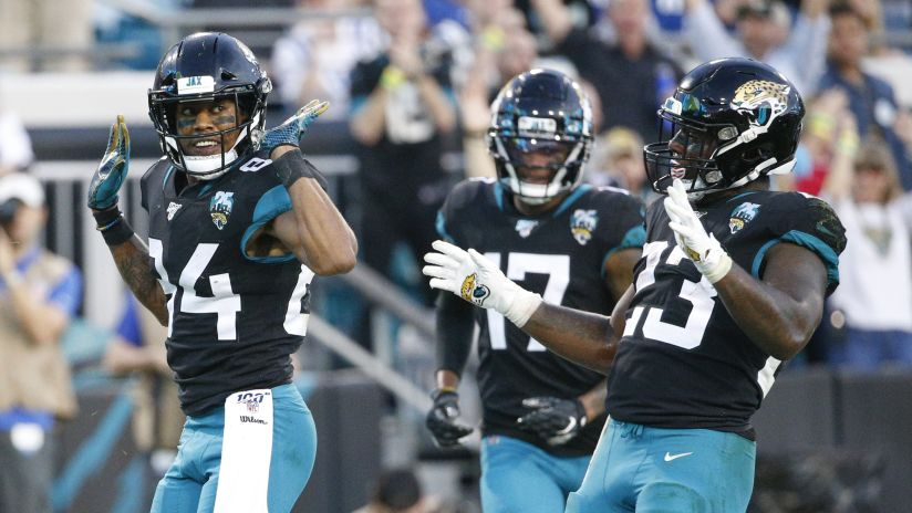Jacksonville Jaguars wide receiver Keelan Cole, left, wide receiver DJ Chark Jr., center, and running back Ryquell Armstead, right, celebrate Cole's touchdown against the Indianapolis Colts during the first half of an NFL football game, Sunday, Dec. 29, 2019, in Jacksonville, Fla. (AP Photo/Stephen B. Morton)