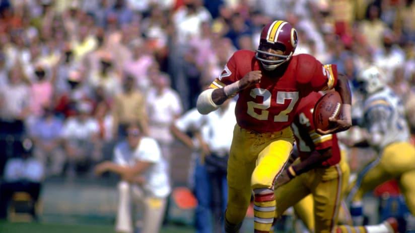 Defensive back Ken Houston of the Washington Redskins runs back an  interception in a 1974 game c8c43df71
