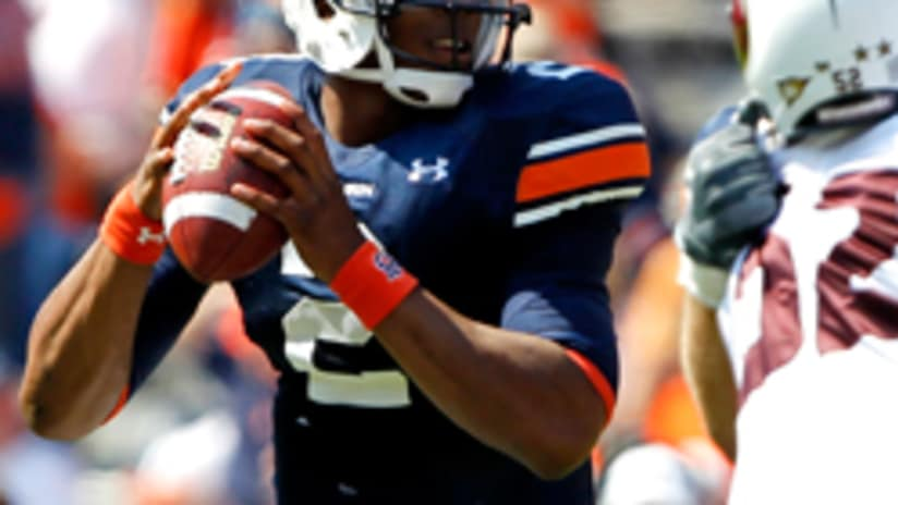 c39b207d5   td    tr   tr   td Auburn QB Cam Newton won the Heisman Trophy and the  BCS national title in his junior season. Next up  Applying for the NFL  Draft.