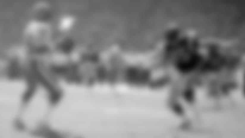 Oct. 23, 1983 -- Rams pass-rusher Jack Youngblood and 49ers quarterback Joe Montana.