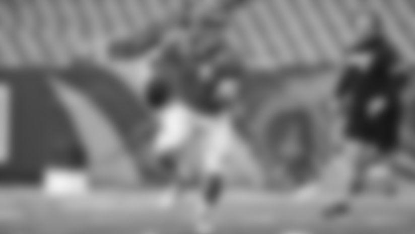Cincinnati Bengals quarterback Joe Burrow (9) scrambles to his right during the team's scrimmage in Cincinnati, Sunday, Aug. 30, 2020.