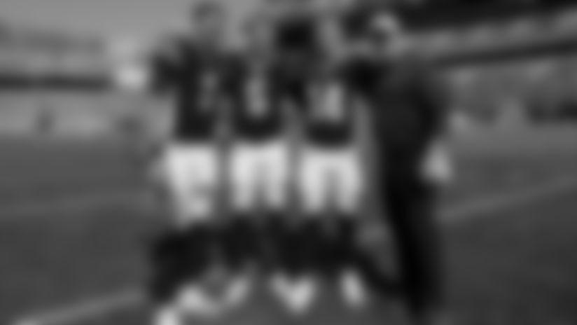 Cincinnati Bengals quarterback Jake Dolegala (7), quarterback Ryan Finley (5), quarterback Andy Dalton (14), and Alex Van Pelt pose for a photo prior to an NFL football game against the Jacksonville Jaguars, Sunday, Oct. 20, 2019, in Cincinnati. (Aaron Doster via AP)