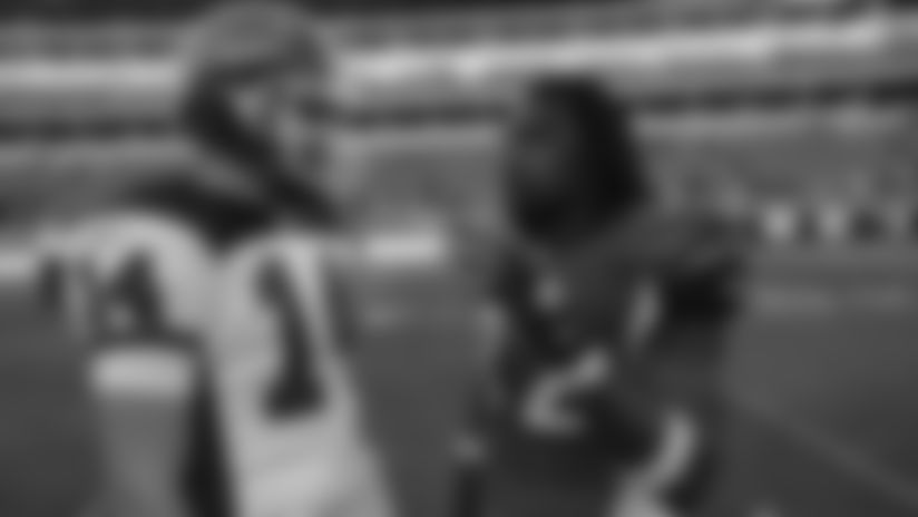 Buffalo Bills quarterback Ryan Fitzpatrick (14) talks with Cincinnati Bengals running back Cedric Benson (32) prior to the start of an NFL football game, Sunday, Nov. 21, 2010, in Cincinnati. (AP Photo/David Kohl)