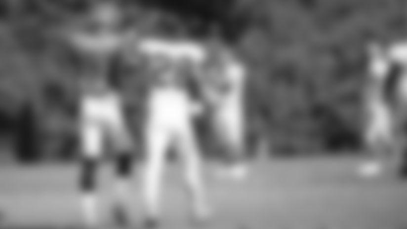 Quarterback Joe Burrow and running back Joe Mixon walk off the field after the team scrimmage.