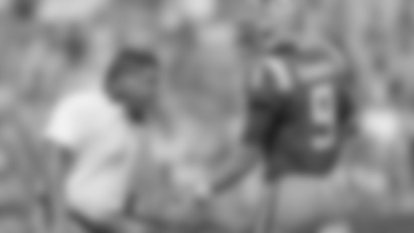 LSU head coach Ed Orgeron congratulates quarterback Joe Burrow (9) after he scored a touchdown in the first half of an NCAA college football game against Utah State in Baton Rouge, La., Saturday, Oct. 5, 2019. (AP Photo/Gerald Herbert)
