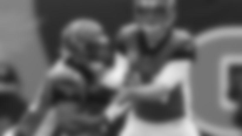 Cincinnati Bengals quarterback Andy Dalton (14) hands the ball to running back Joe Mixon (28) in the first half of an NFL football game against the Arizona Cardinals, Sunday, Oct. 6, 2019, in Cincinnati. (AP Photo/Gary Landers)