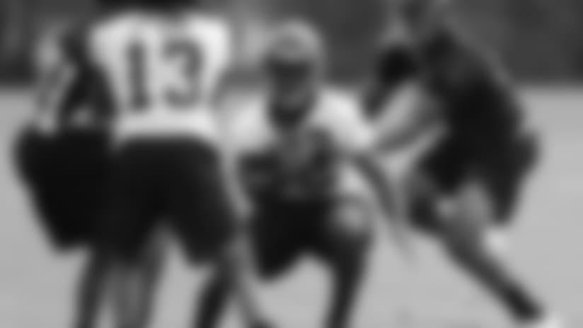 Cincinnati Bengals running back Mark Walton, center, participates in the NFL football team's rookie minicamp, Friday, May 11, 2018, in Cincinnati. (AP Photo/John Minchillo)