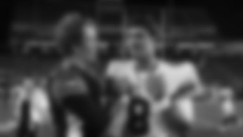 Cincinnati Bengals quarterback Ryan Finley (5) meets with New York Giants quarterback Daniel Jones (8) after an NFL preseason football game Thursday, Aug. 22, 2019, in Cincinnati. (AP Photo/Gary Landers)