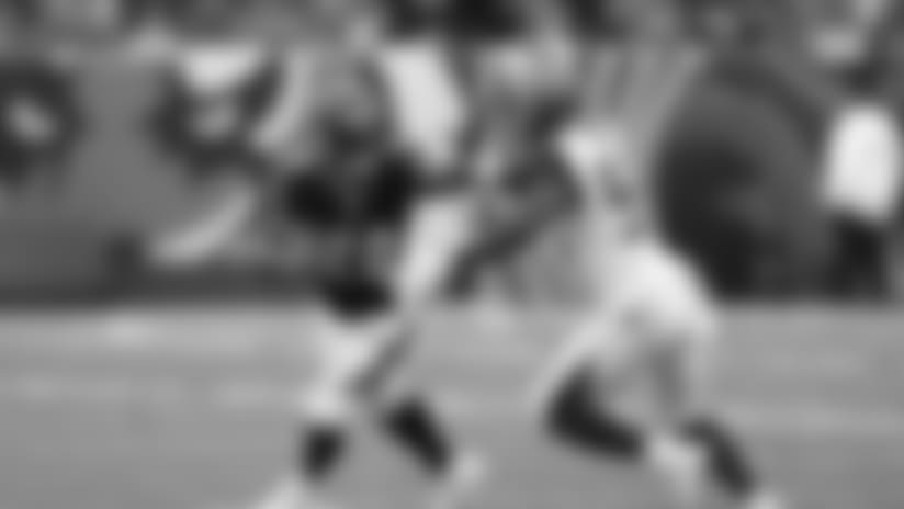 Cincinnati Bengals running back Joe Mixon (28) holds off Tampa Bay Buccaneers linebacker Lavonte David (54) during the first half of an NFL football game in Cincinnati, Sunday, Oct. 28, 2018. (AP Photo/Gary Landers)