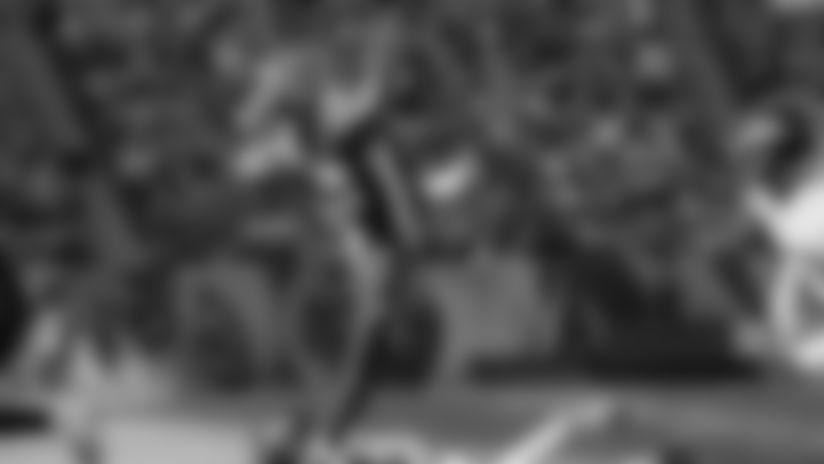 Cincinnati Bengals running back Joe Mixon (28) leaps over Baltimore Ravens defensive back Chuck Clark, below, during the first half of NFL football game, Sunday, Nov. 10, 2019, in Cincinnati. (AP Photo/Frank Victores)