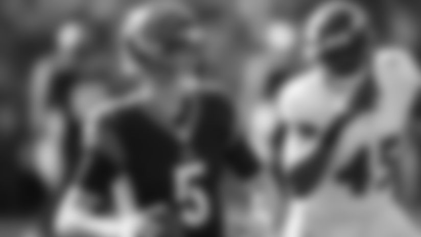 Cincinnati Bengals quarterback Ryan Finley (5) looks to pass under pressure from Baltimore Ravens linebacker Jaylon Ferguson (45) during the first half of NFL football game, Sunday, Nov. 10, 2019, in Cincinnati. (AP Photo/Gary Landers)