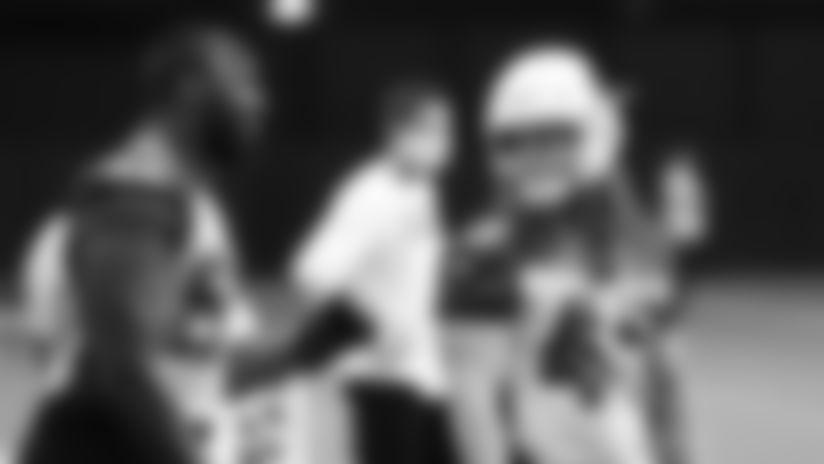 Arizona Cardinals outside linebacker Chandller Jones (left) and inside linebacker Dennis Gardeck talk during practice on August 12, 2020.