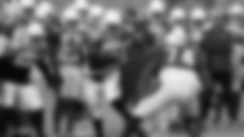 Arizona Cardinals defensive end Chandler Jones (55) an linebacker D.J. Humphries (74) run drills as teammates watch during an NFL football practice, Monday, July 30, 2018, in Glendale, Ariz. (AP Photo/Matt York)