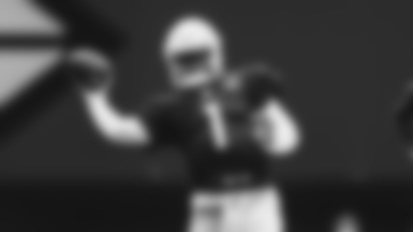 QB Kyler Murray delivers a sidearm throw during a 2019 camp practice