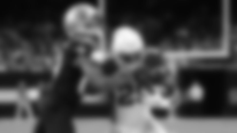Cardinals running back Chase Edmonds (29) carries the ball against Saints cornerback Marshon Lattimore (23).