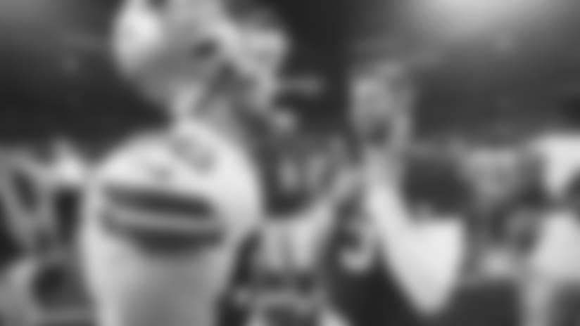 Cardinals quarterback Josh Rosen (right) talks with Cowboys tight end Dalton Schultz Sunday after Arizona's win.