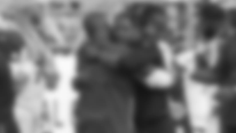 Cardinals coach Steve Wilks (right) hugs defensive coordinator Al Holcomb after Wilks got his first win as an NFL head coach Sunday when his team beat the 49ers, 28-18.