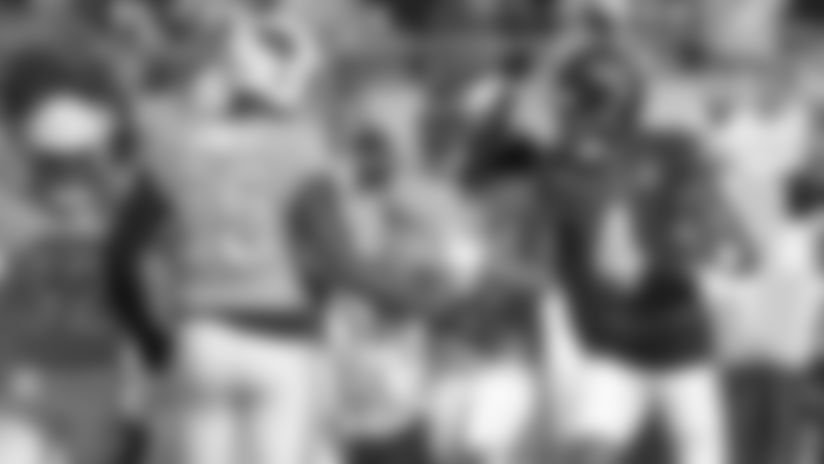 Cardinals linebacker Chandler Jones congratulates Texans quarterback Deshaun Watson after a TD pass in the Pro Bowl played in 2020.