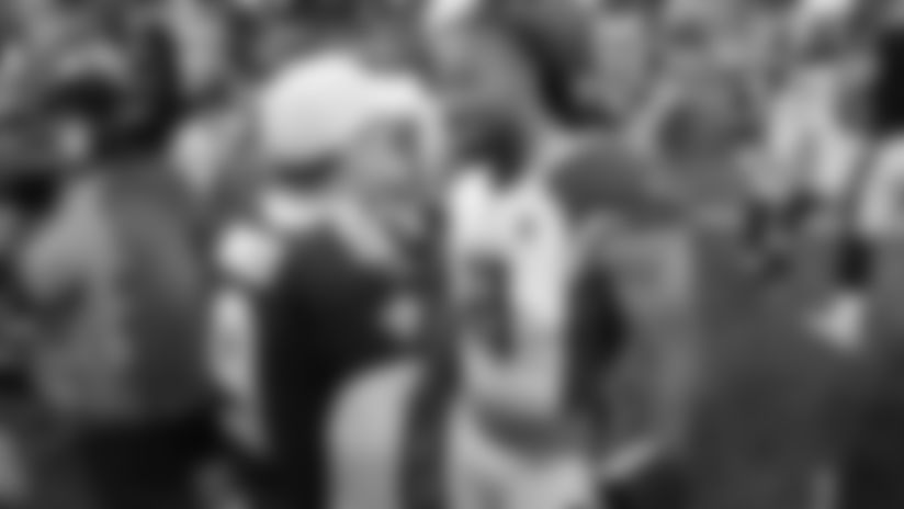 Saints QB Drew Brees and WR Larry Fitzgerald talk after a 2018 preseason game