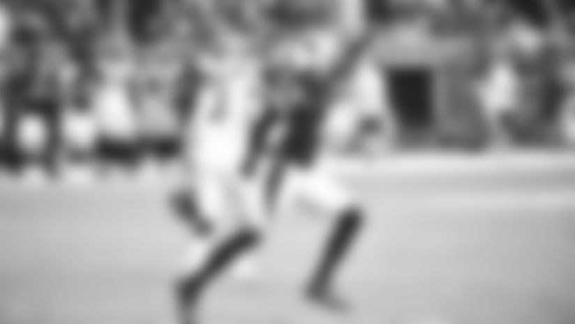S Budda Baker celebrates the missed extra point of Falcons K Matt Bryant Sunday.