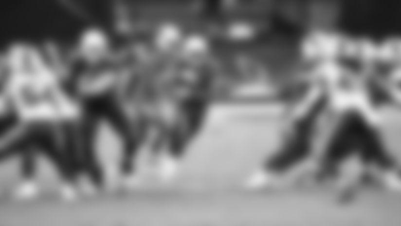 RB Kenyan Drake runs through a big hole against the Bills in a 2020 home game