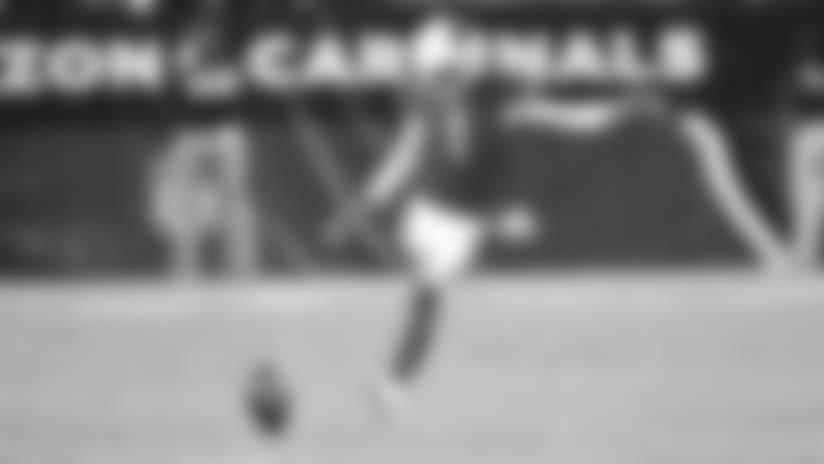 Rookie kicker Matt McCrane kicks off for the Cardinals during a preseason game.