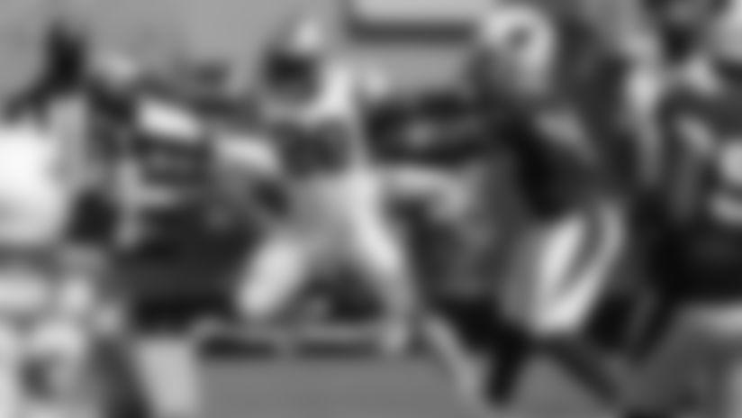 Carolina Panthers running back Mike Davis runs past Arizona Cardinals middle linebacker Jordan Hicks during the first half of an NFL football game Sunday, Oct. 4, 2020, in Charlotte, N.C. (AP Photo/Brian Blanco)