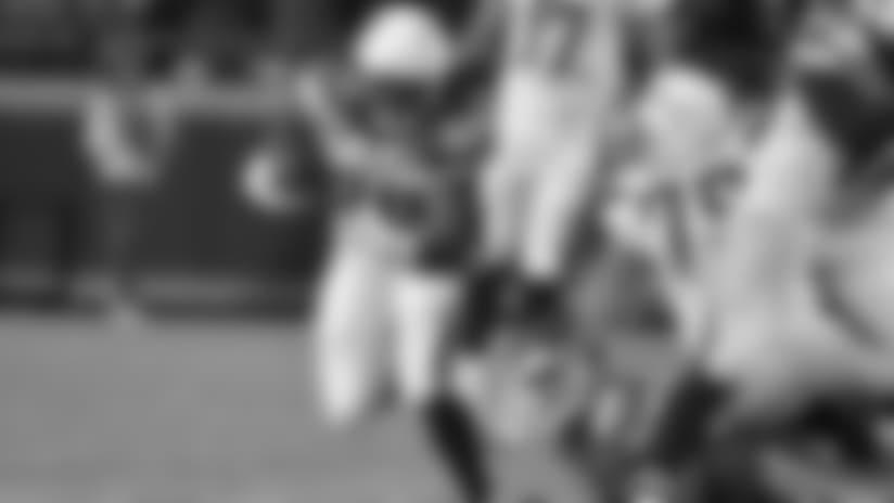Los Angeles Chargers running back Melvin Gordon (28) runs away from Kansas City Chiefs linebacker Derrick Johnson (56) during the first half of an NFL football game in Kansas City, Mo., Saturday, Dec. 16, 2017. (AP Photo/Ed Zurga)