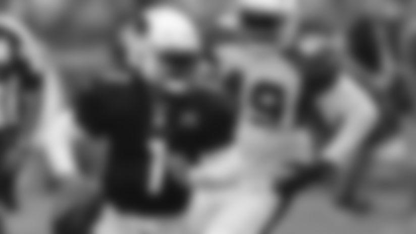 Arizona Cardinals' Kyler Murray (1) evades the rush during an NFL football training camp scrimmage, Saturday, Aug. 3, 2019, in Glendale, Ariz. (AP Photo/Matt York)