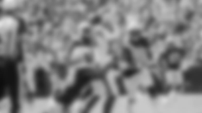 Melvin Ingram takes down Buffalo Bills QB Josh Allen in Sunday's game at New Era Field.