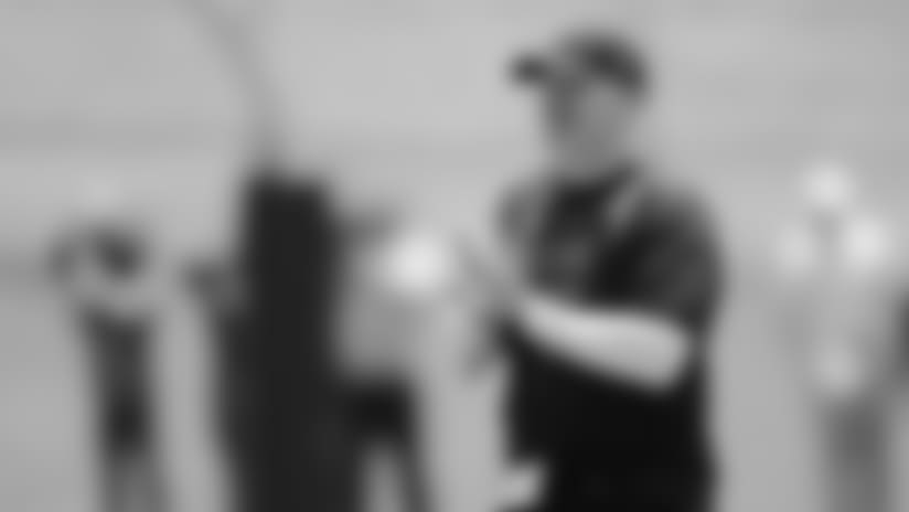 Atlanta Falcons quarterback Matt Ryan #2 high-fives Atlanta Falcons head coach Dan Quinn during the first half against the Chicago Bears on September 27, 2020. (Photo by Kyle Hess/Atlanta Falcons)