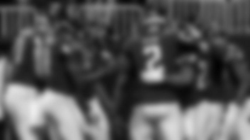 Atlanta Falcons quarterback Matt Ryan #2 hugs running back Devonta Freeman #24 as the team crowds in after an early first quarter touchdown by Freeman at Mercedes-Benz Stadium in Atlanta, GA, on Sunday December 22, 2019. (Photo by Adam Hagy/Atlanta Falcons)