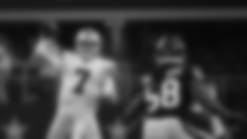 Dallas Cowboys quarterback Cooper Rush (7) throws a pass as Houston Texans linebacker Peter Kalambayi (58) defends in the first half of a preseason NFL football game in Arlington, Texas, Saturday, Aug. 24, 2019. (AP Photo/Michael Ainsworth)