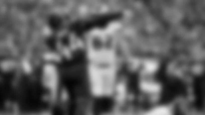 Jacksonville Jaguars linebacker Myles Jack (44) reacts after sacking Philadelphia Eagles quarterback Carson Wentz (11), right, during the second half of an NFL football game at Wembley stadium in London, Sunday, Oct. 28, 2018. (AP Photo/Matt Dunham)