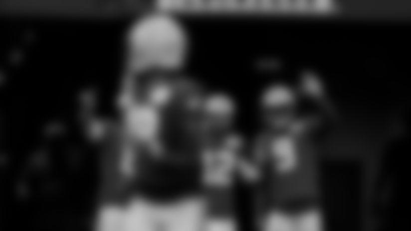 Quarterbacks Manny Wilkins, Aaron Rodgers, DeShone Kizer