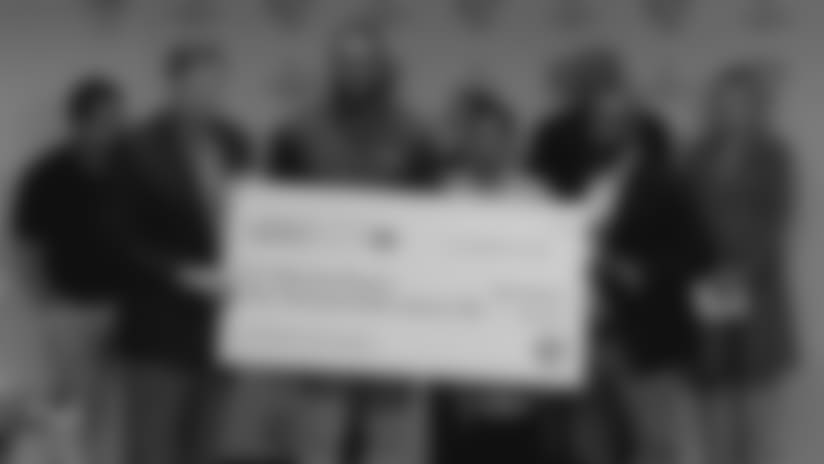 Kendricks presents $50,000 check to the Sherman Phoenix Project