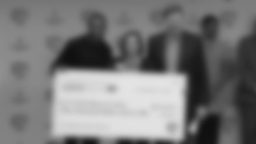 Cobb presents check for $50,000 to CASA Brown County